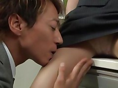 Short haired babe Yuuki is working at the office and her colleague starts naughty things with her. She can't refuse him and as well starts to enjoy with him. He spreads her legs and starts rubbing her pussy & after some time he begins to undress her right in the office.