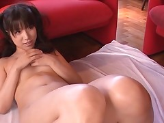 Busty Asian charms a throbbing pecker with juicy sucking